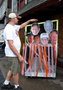 creator of the Cubber's Pizza outhouse, naming all of the morning regulars whose faces decorate the craft